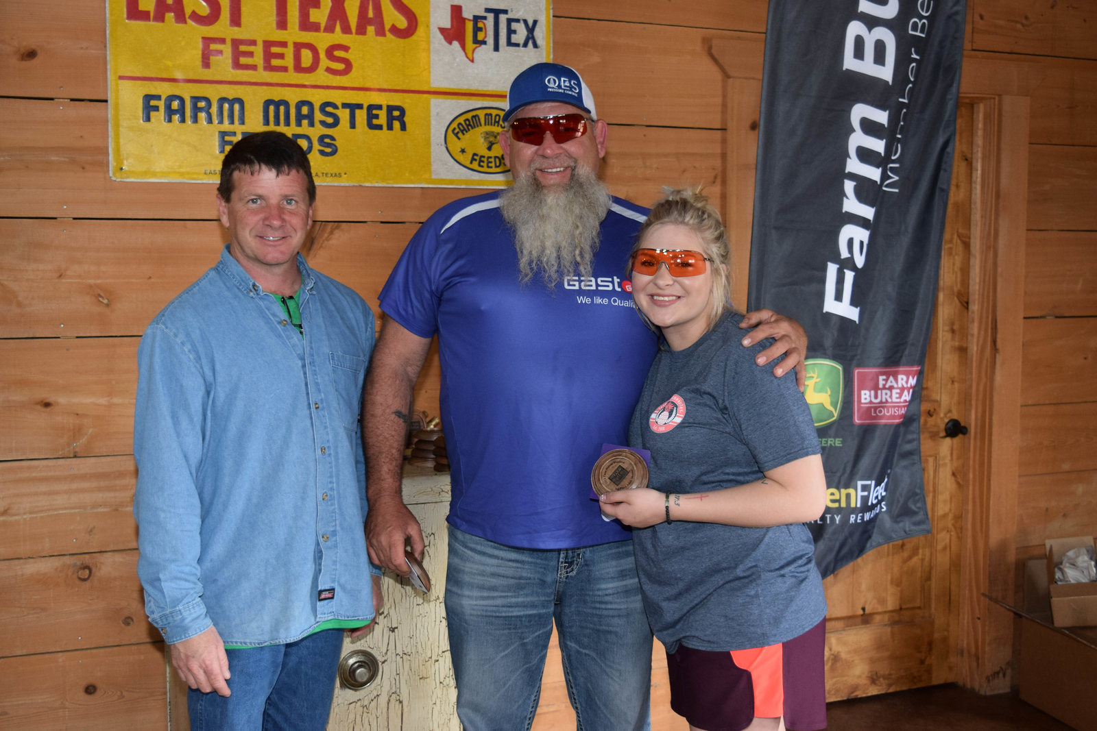 Tristen Owens, right, won 3rd place Adult Shooter and Dwayne Owens won 2nd place Adult Shooter at the 2018 Louisiana Farm Bureau Sporting Clays Shootout. Pictured them is Louisiana Farm Bureau DeSoto Parish President Joey Register.