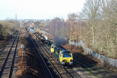 Freightliner's 70017 opens up on the climb past Oakenshaw Junction with the lightly loaded 4O95 1213 Leeds FLT - Southampton Maritime intermodal (07/02/2018)