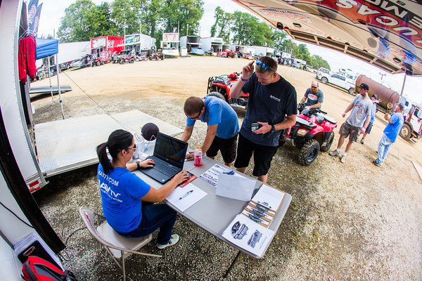 Steve Casebolt and Kent Robinson sign in with Lucas Oil Late Model Dirt Series official Ashley Schwallie
