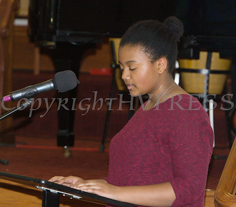 Nia Garcia offers a reading on Prathia Hall as Bethel Missionary Baptist Church hosted the 30th Annual Martin Luther King, Jr. Community Commemorative Service on Sunday, January 14, 2018. Hudson Valley Press/CHUCK STEWART, JR.