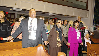 "The congregation joins hands in unity while singing ""We Shall Overcome"" at the Bethel Missionary Baptist Church hosted 30th Annual Martin Luther King, Jr. Community Commemorative Service on Sunday, January 14, 2018. Hudson Valley Press/CHUCK STEWART, JR."