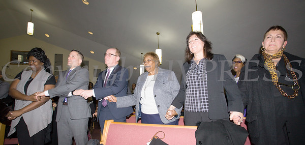 "Dutchess County Executive Marcus Molinaro, Poughkeepsie Mayor Rob Rolison, Dutchess County Legislator Barbara Jeter-Jackson, and NY State Senator Sue Serino join hands with others in unity while singing ""We Shall Overcome"" at the Dutchess County African American Clergy Association's 49th Annual Commemorative Service on Sunday, January 14, 2018 at Beulah Baptist Church in Poughkeepsie, NY. Hudson Valley Press/CHUCK STEWART, JR."