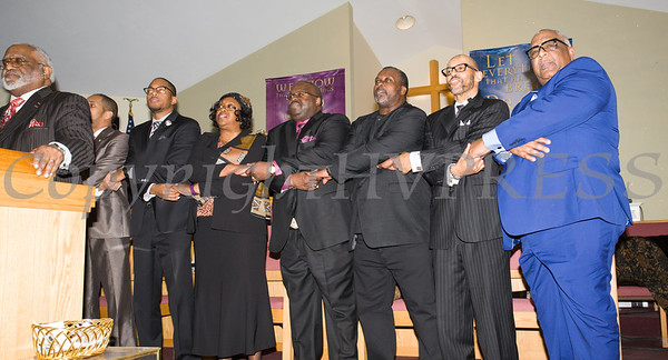 """The congregation joins hands in unity while singing """"We Shall Overcome"""" at the Dutchess County African American Clergy Association's 49th Annual Commemorative Service on Sunday, January 14, 2018 at Beulah Baptist Church in Poughkeepsie, NY. Hudson Valley Press/CHUCK STEWART, JR."""