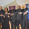 "The congregation joins hands in unity while singing ""We Shall Overcome"" at the Dutchess County African American Clergy Association's 49th Annual Commemorative Service on Sunday, January 14, 2018 at Beulah Baptist Church in Poughkeepsie, NY. Hudson Valley Press/CHUCK STEWART, JR."