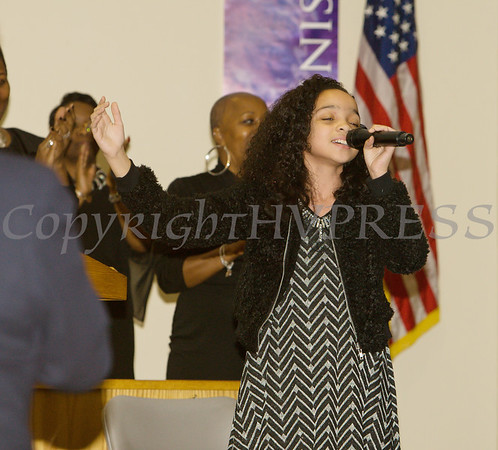 Miss Madison Bishop, 11, brings everyone to their feet with her musical selection as the Dutchess County African American Clergy Association held its 49th Annual Commemorative Service on Sunday, January 14, 2018 at Beulah Baptist Church in Poughkeepsie, NY. Hudson Valley Press/CHUCK STEWART, JR.