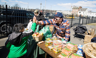 Just Say Yes to Fruits and Vegtables handed out free produce during the We Are Newburgh and the City of Newburgh Annual Easter Egg Hunt at the Activity Center on Saturday, March 24, 2018. Hudson Valley Press/CHUCK STEWART, JR.