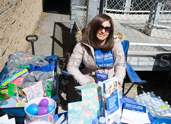 Patria Sierra with United Healthcare handed out goodies and information as We Are Newburgh and the City of Newburgh held the Annual Easter Egg Hunt at the Activity Center on Saturday, March 24, 2018. Hudson Valley Press/CHUCK STEWART, JR.