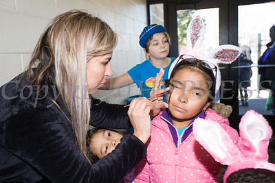 Talita Thomaz paints nine-year-old Jennifer's face during the We Are Newburgh and the City of Newburgh Annual Easter Egg Hunt at the Activity Center on Saturday, March 24, 2018. Hudson Valley Press/CHUCK STEWART, JR.