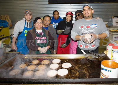 Kitchen workers prepared the free hot dogs and hamburgers that were handed out as We Are Newburgh and the City of Newburgh held the Annual Easter Egg Hunt at the Activity Center on Saturday, March 24, 2018. Hudson Valley Press/CHUCK STEWART, JR.