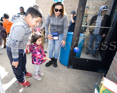 Linetty Romero of United Healthcare plays a fun game with kids as We Are Newburgh and the City of Newburgh held the Annual Easter Egg Hunt at the Activity Center on Saturday, March 24, 2018. Hudson Valley Press/CHUCK STEWART, JR.