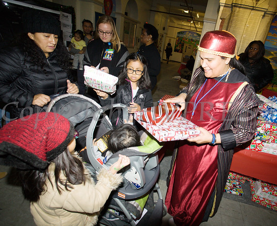 Toys were distributed at the conclusion of the Hudson River HealthCare sponsored Three Kings Day celebration on Saturday, January 6, 2017 at the Family Partnership Center in Poughkeepsie, NY. Hudson Press/CHUCK STEWART, JR.