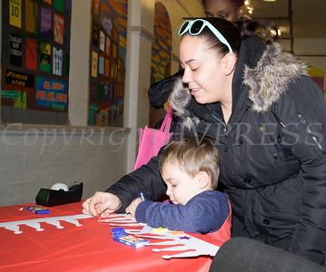 Danielle brought her two-year-old son Austin to the Hudson River HealthCare sponsored Three Kings Day celebration on Saturday, January 6, 2017 at the Family Partnership Center in Poughkeepsie, NY. Hudson Press/CHUCK STEWART, JR.
