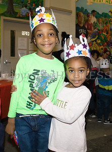 Amaziah 6 and Abby, 3, show off their newly created Three Kings Crowns at the Hudson River HealthCare sponsored Three Kings Day celebration on Saturday, January 6, 2017 at the Family Partnership Center in Poughkeepsie, NY. Hudson Press/CHUCK STEWART, JR.