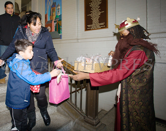 People received Rosca de Reyes or Kings' Bread at the conclusion of the Hudson River HealthCare sponsored Three Kings Day celebration on Saturday, January 6, 2017 at the Family Partnership Center in Poughkeepsie, NY. Hudson Press/CHUCK STEWART, JR.