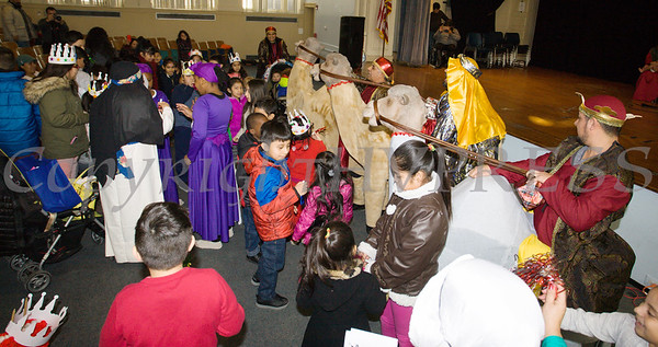 Children are excited at the arrival of the Three Kings on camels, thanks to performers from Peekskill Comite Latino, as part of the Hudson River HealthCare sponsored Three Kings Day celebration on Saturday, January 6, 2017 at the Family Partnership Center in Poughkeepsie, NY. Hudson Press/CHUCK STEWART, JR.