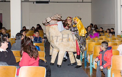 The Three Kings arrived on camels, thanks to performers from Peekskill Comite Latino, as part of the Hudson River HealthCare sponsored Three Kings Day celebration on Saturday, January 6, 2017 at the Family Partnership Center in Poughkeepsie, NY. Hudson Press/CHUCK STEWART, JR.