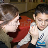 AmeriCorp Volunteer Jessica Shamdas paints 11-year-old Khristian's face during the Hudson River HealthCare sponsored Three Kings Day celebration on Saturday, January 6, 2017 at the Family Partnership Center in Poughkeepsie, NY. Hudson Press/CHUCK STEWART, JR.