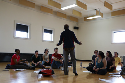 Guest artist Daniel Avorgbedor works with the students in Dr. S. Ama Wray's course.