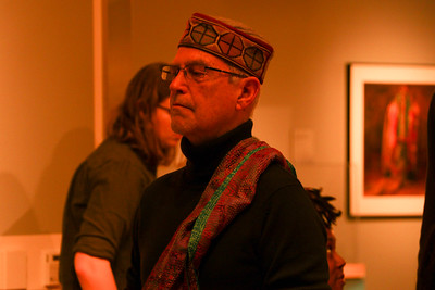 Evjue-Bascom Professor Henry Drewal interacts with the environment at the Ruth Davis Design Gallery.