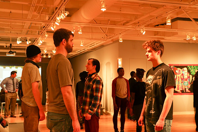 """Students from Dr. Wray's """"Art of Improvisation"""" course interact with the environment at the Ruth Davis Design Gallery."""