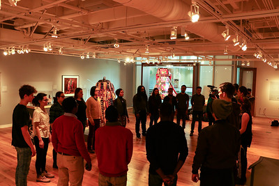 """Students from Dr. Wray's """"Art of Improvisation"""" course explore the exhibition at the Ruth Davis Design Gallery."""