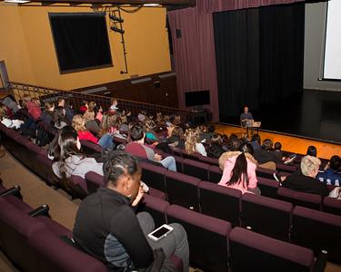 "Audience members listen as Fleeta Chew Siegel speaks about ""Interdisciplinary Approaches to the Art of Improvisation."""