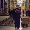 The church is managed by no fewer than six different Christian denominations, here a Greek Orthodox priest carries a ceremonial vessel