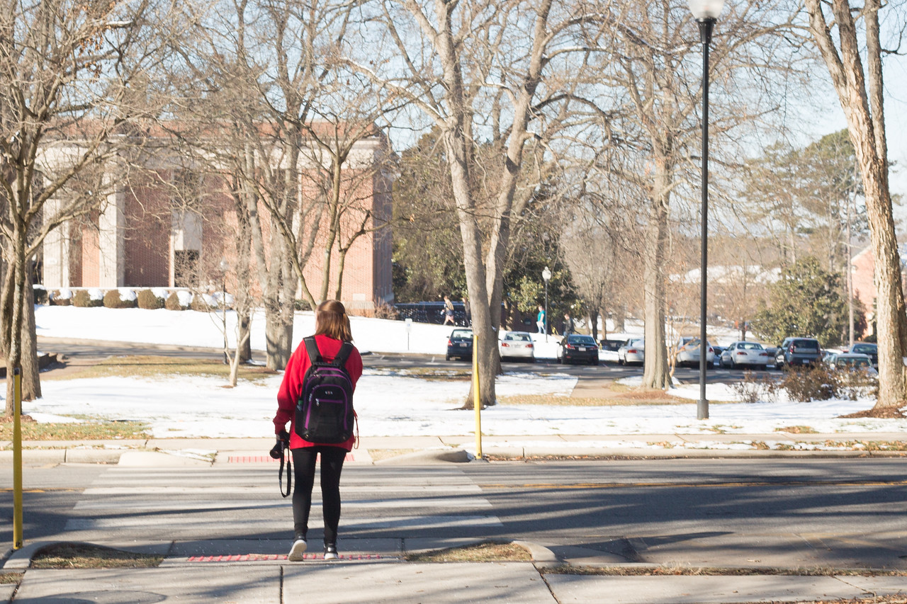 Junior, Hannah Anders, makes the snowy trek from class on Friday, the first day back to school after 2 consecutive snow days.