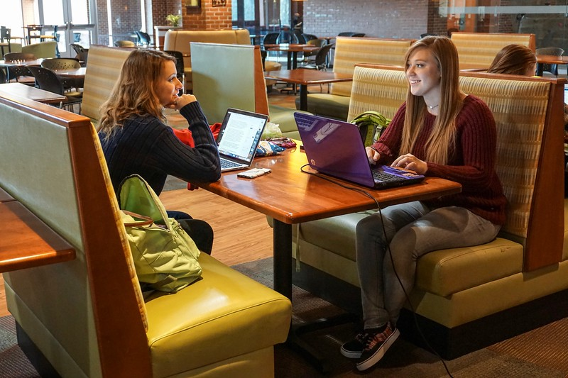 Allison Wilder and Lauren Mahoney chat while studying in Tucker Student Center