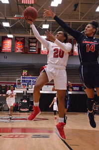 Ky'Asia Stanford (#20)  goes for a layup in Saturday's game against Liberty.