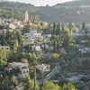 "This is the village of Ein Karem, our destination. Its name translates to ""Spring of the Valley"". It is an ancient village of the Jerusalem District and now a neighbourhood in southwest Jerusalem. According to Christian tradition, John the Baptist was born in Ein Karem, leading to the establishment of many churches and monasteries."
