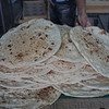 Fresh flat bread, right out of the oven. I bought a piece and it was delicious