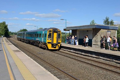 21 June 2018 :: Slowing to pick up passengers at Lydney is 158 818 and the train is 2L65, the 1700 from Gloucester to Maesteg