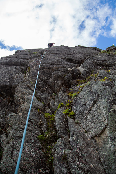 Noah nears the arete and topout on <i>Could Be Better 5.8</i> at the Jungle Gym in Archangel Valley.