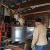 DARREL CHECKING THE NEW SAP FILTRATION EXPERIMENT....
