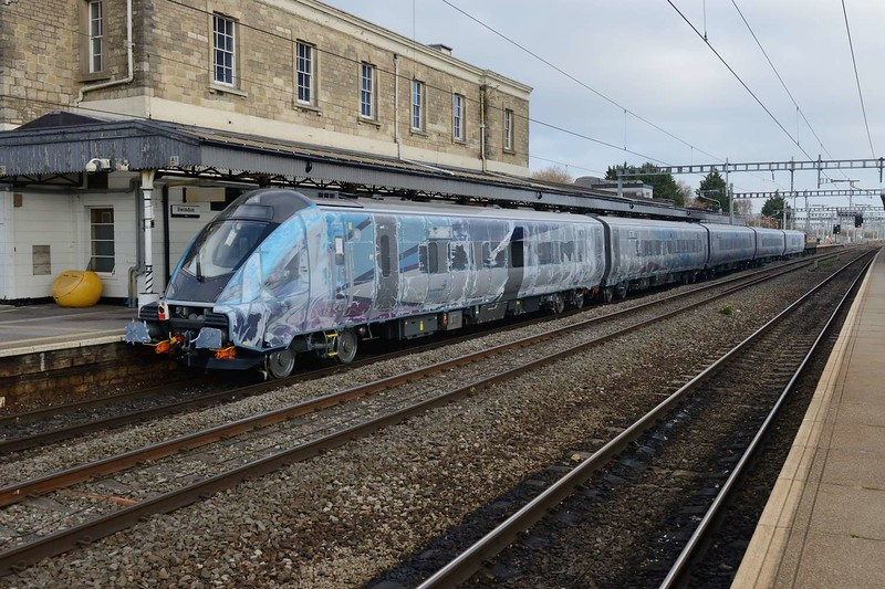 15 November 2018 :: A view of the new TransPennine Mk 5 set being hauled by 57305 is seen at Swindon still in its protective plastic cover for the journey