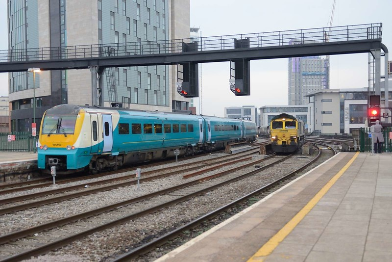 22 November 2018 :: Now unbranded, 175 110 depart from Cardiff Central with 1W66, the 1405 from Carmarthen to Manchester Piccadilly.  Also  seen is 66529 working 6C93 from East Usk Yard to Port Talbot