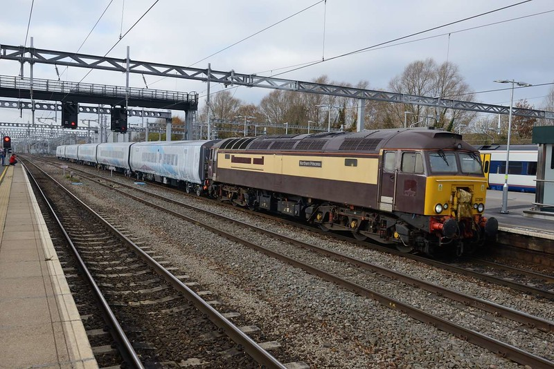 15 November 2018 :: Still in Pullman colours but with its Northern Belle logo blanked out, 57305 passes through Swindon working train 5Q32 hauling a new TransPennine Mk 5 set from Portbury to Manchester