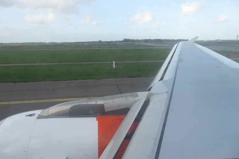 Flying from London Luton to Amsterdam Schiphol on EasyJet white liveried Airbus A319 G-EZEH, 03.10.2018.