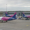 Three WizzAir Airbus A320 / A321 aircraft at the new south stand at London Luton Airport, the nearest being HA-LWO departing for Riga, 03.10.2018.