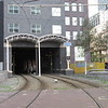 Den Haag tram lines 9 and 12 head under a building between Kalvermarkt and Centraal station, 03.10.2018.