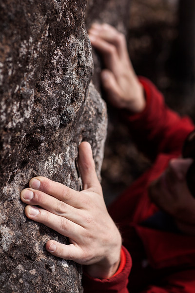 """Divots in the rock provide just enough texture to sink the fingertips into and move higher on this boulder problem.<br /> <br /> See the behind-the-scenes here: <a href=""""https://www.morffed.com/2018/Photo-A-Month-Behind-The-Scenes/i-vBdcX3w/A"""">https://www.morffed.com/2018/Photo-A-Month-Behind-The-Scenes/i-vBdcX3w/A</a>"""