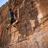 Pat pulls into the crux on <i>Skeet Surfin' 5.10d</i> at the Gun Club in Las Vegas, Nevada.
