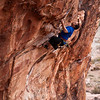Kelsey pulls the steep jugs of <i>Drilling Miss Daisy 5.11a</i> at the Conundrum Crag in Red Rocks, Nevada.