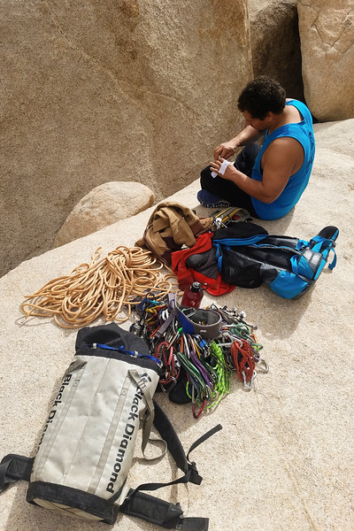 Kelsey gears up at the base of a climb in Joshua Tree.