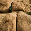 The first offwidth crux of <i>Comic Book 5.10</i> In Joshua Tree, California.