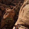 Kelsey nears the top on the beautiful <i>Illusion Dweller 5.10</i> in Joshua Tree.