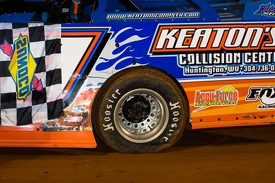 Eddie Carrier, Jr. had a tire going flat in victory lane
