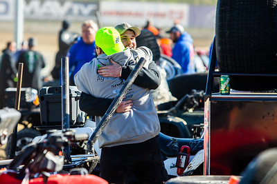 Best Performance Motorsports crew member Brad Ramsey is congratulated by Tyler Breashears