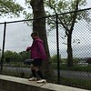 ELLIE WAITING FOR ALEX'S SOCCER GAME TO START ON A RAINY SATURDAY.